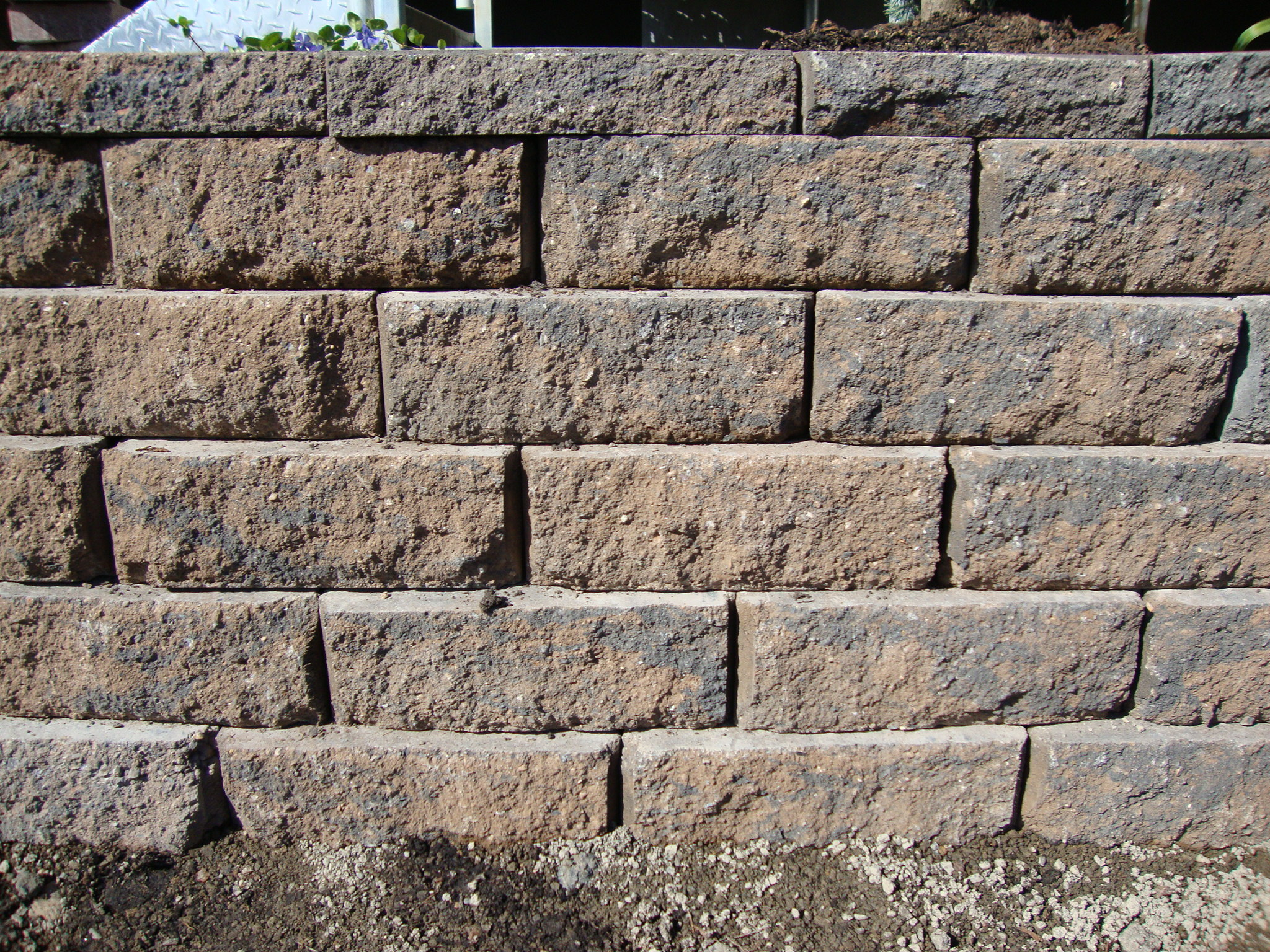 Retaining wall blocks portland rock and landscape supply for Block wall landscape design
